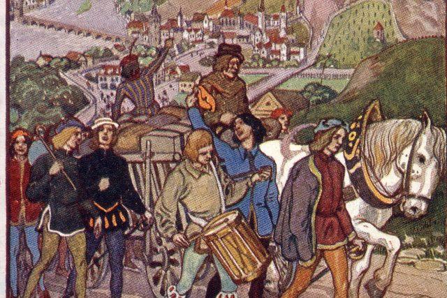 Odchod německých studentů z Prahy v roce 1409. Pohlednice ze začátku 20. století.  | foto: Wikimedia Commons
